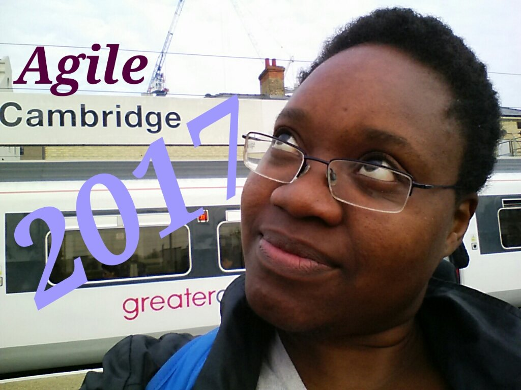 Selfie of Kathleen musing at Cambridge train station, the words Agile Cambridge 2017 appear on the photo
