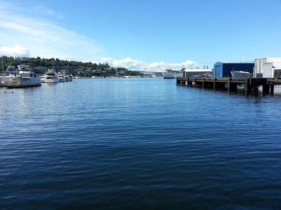 Beautiful lake in Seattle, lots of blue water and blue sky, boats in the distance (Lake Union, Seattle, Washington, USA)