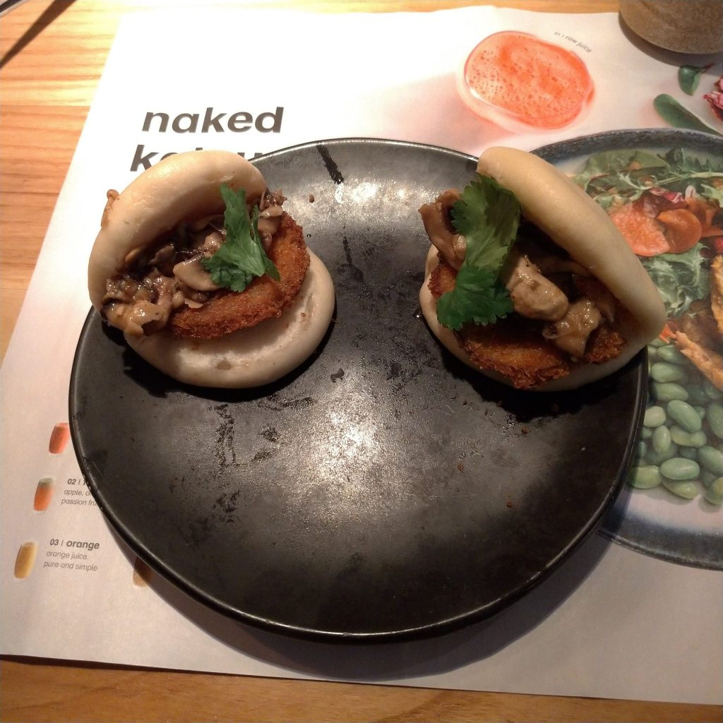 bao buns filled with mushrooms, breaderd aubergine and coriander