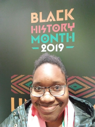 LiLi Kathleen smiling with words 'Black History Month 2019' emblazoned boldy above
