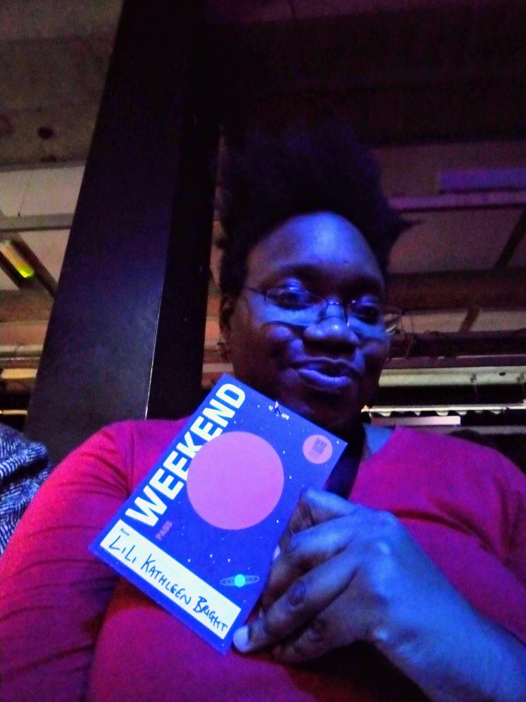 selfie of LiLi Kathleen, posing with a Weekend pass for Afrotech Fest