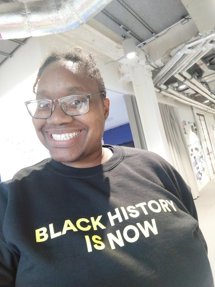 LiLi smiling in a black history is now jumper