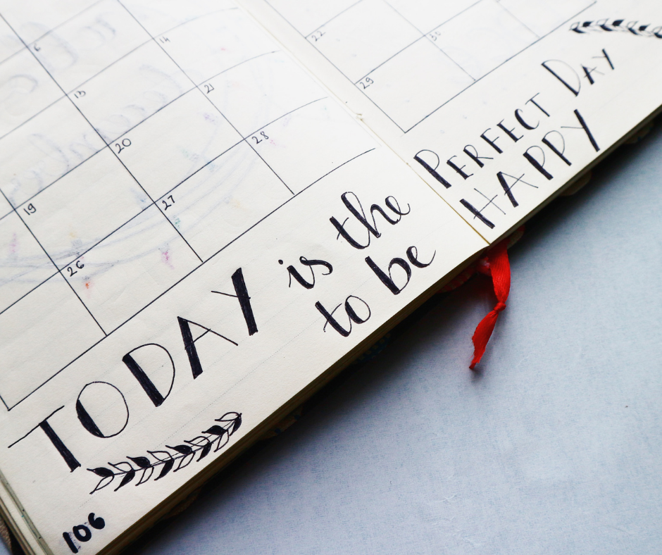 open planner with caption 'TODAY is the perfect day to be happy'