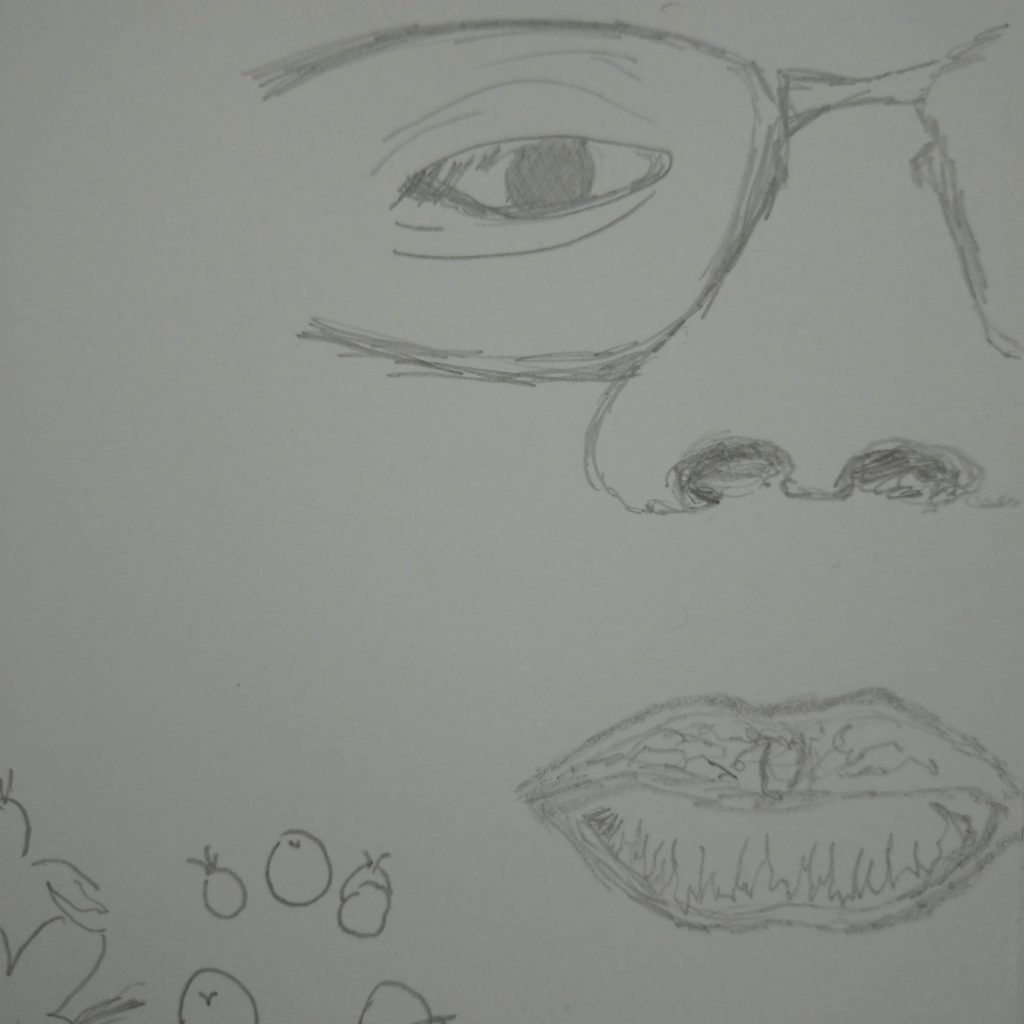 close-up of a face line drawing at the edge of the page bisecting the face