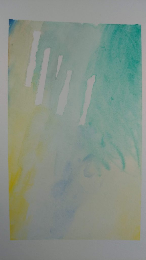 yellows, blues and greens bleed and blend on a page in a rectangle, that are rectangular patches unpainted, showing the white of the paper